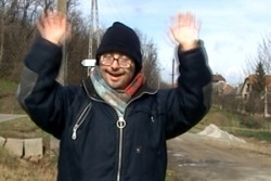 image of an actor standing in a road with his hands in the air Oska Bright