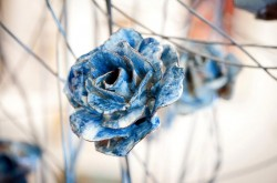 a delicate blue ceramic flower is show in bloom as part of Paul Cummins English Flower Garden