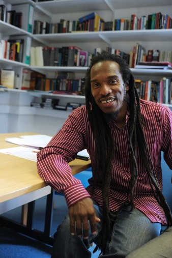 portrait image of performance poet Benjamin Zephaniah in a library
