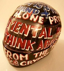 photo of a motorcycle helmet turned into a visual poem from artist Vince Laws