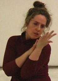 still of denise armstrong, hands raised in a performance within a piece by alison jones