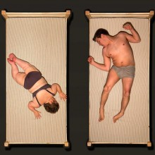 still from a film by Jo Verrent and Luke Pell showing an overview of two disabled people in their underwear lying on beds in two separate screens