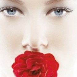 photoshopped image of a young woman's face with a red rose in her mouth