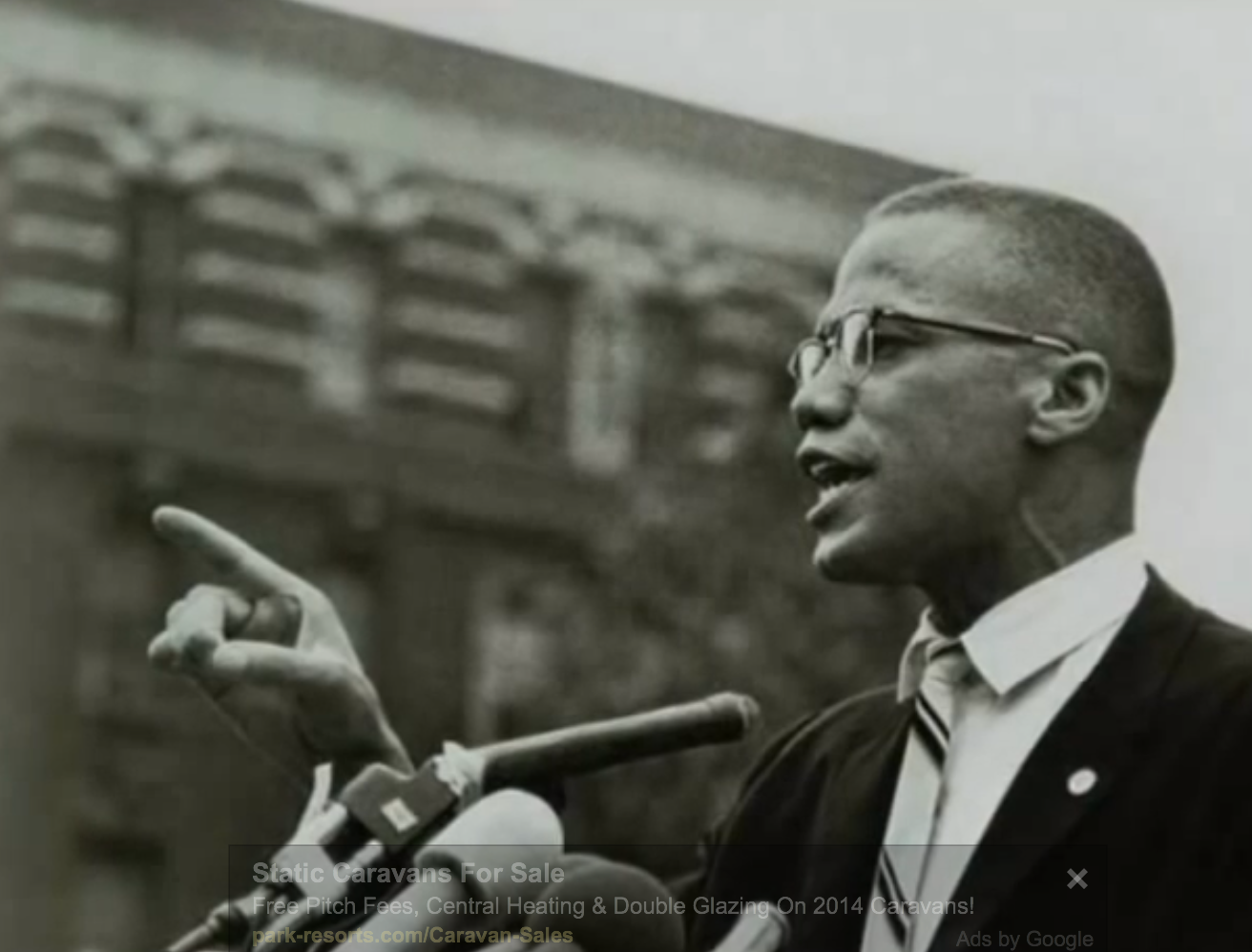 black and white photo of Malcolm X