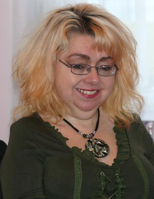 photo of writer penny pepper smiling at the camera